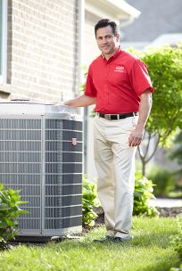 HVAC technician with air conditioning unit